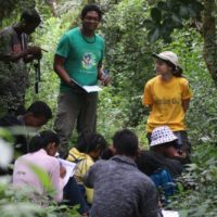 Primatologist Naina Rabemananjara explains field methods for following lemurs in the Tsinjoarivo Forest.