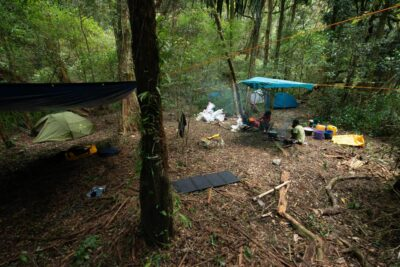 Image of a quick camp setup including shelters for cooking and eating, and tents for sleeping