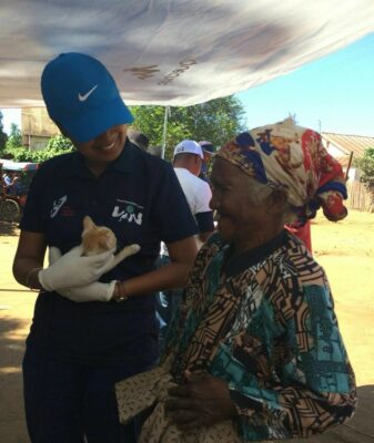 Dr. Zoavina Randriana greets a cat owner eager to get her furry friend vaccinated.